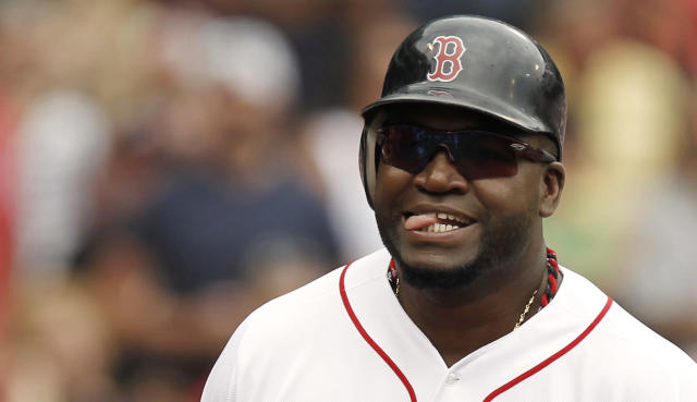 BOSTON, MA - JULY 7: David Ortiz #34 of the Boston Red Sox sticks out his tongue after scoring during the fourth inning of game one of a doubleheader against the New York Yankees at Fenway Park on July 7, 2012 in Boston, Massachusetts. (Photo by Winslow Townson/Getty Images)