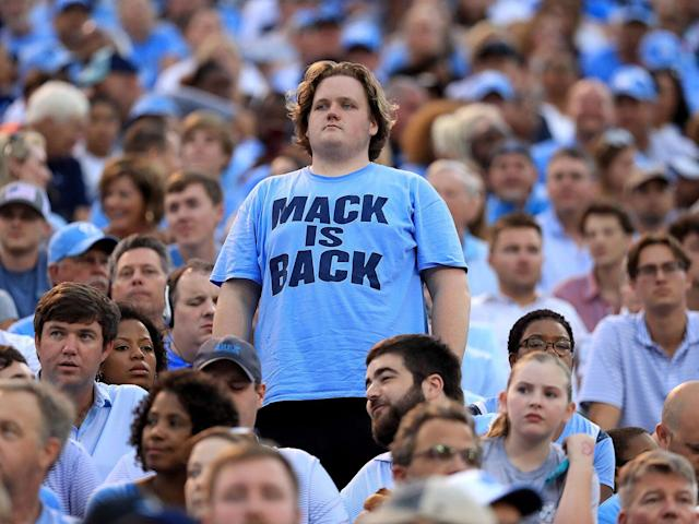 <p>A fan watches on during the game between North Carolina and Wake Forest at BB&T Field on Sept. 13, 2019.</p>