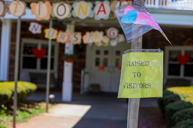 A sign posted near the entrance to the Kimberly Hall South nursing home shows the home closed to visitors, Thursday, May 14, 2020 in Windsor, Conn.
