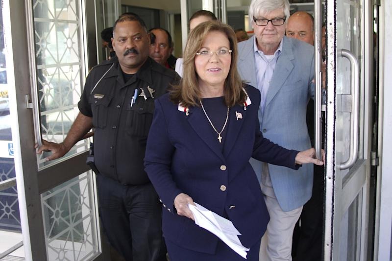 Pennsylvania Supreme Court Justice Joan Orie Melvin, center, leaves Pittsburgh Municipal Court after a hearing on charges she illegally used her state-funded staff to perform campaign work on Friday, May 18, 2012 in Pittsburgh. Orie Melvin said after the hearing that she is not guilty of campaign corruption charges connected to her bids for a seat on the high court.   (AP Photo/Keith Srakocic)(AP Photo/Keith Srakocic)
