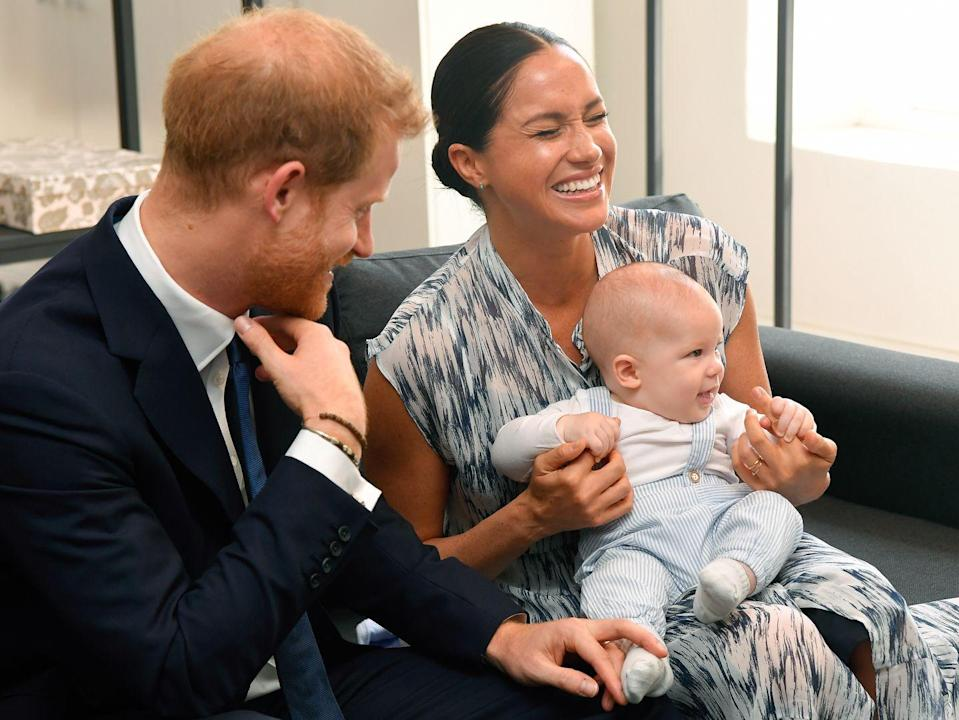 <p>Harry and Meghan share a moment with baby Archie during a meeting with Archbishop Desmond Tutu in Cape Town.</p>