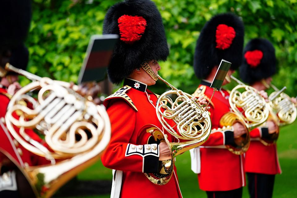 The Band of the Coldstream Guards plays 'Three Lions' and 'Sweet Caroline' in the gardens of Clarence House in London on July 6, 2021, ahead of England's UEFA EURO 2020 semi-final football match against Denmark on July 7. (Photo by Victoria Jones / POOL / AFP) (Photo by VICTORIA JONES/POOL/AFP via Getty Images)