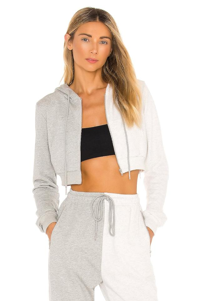 """<p>We love this unique two-toned <product href=""""https://www.revolve.com/superdown-renna-cropped-hoodie/dp/SPDW-WK136/?d=Womens&amp;page=1&amp;lc=45&amp;itrownum=12&amp;itcurrpage=1&amp;itview=05"""" target=""""_blank"""" class=""""ga-track"""" data-ga-category=""""Related"""" data-ga-label=""""https://www.revolve.com/superdown-renna-cropped-hoodie/dp/SPDW-WK136/?d=Womens&amp;page=1&amp;lc=45&amp;itrownum=12&amp;itcurrpage=1&amp;itview=05"""" data-ga-action=""""In-Line Links"""">Superdown Renna Cropped Hoodie</product> ($68).</p>"""