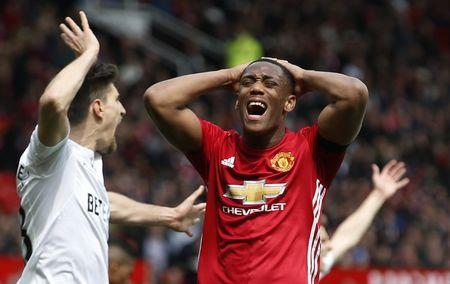 Britain Football Soccer - Manchester United v Swansea City - Premier League - Old Trafford - 30/4/17 Manchester United's Anthony Martial looks dejected after a missed chance Reuters / Andrew Yates Livepic