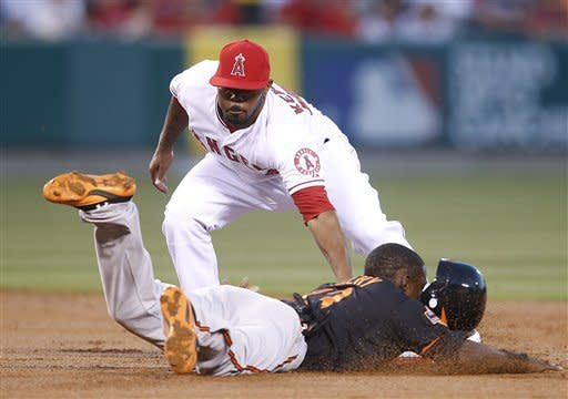 Los Angeles Angels second baseman Howard Kendrick, top, tags out Baltimore Orioles' Xavier Avery in the third inning of a baseball game in Anaheim, Calif., Friday, July 6, 2012. (AP Photo/Jae C. Hong)