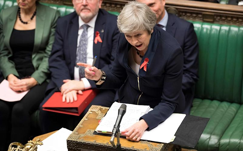 Theresa May goes head to head with Jeremy Corbyn in the weekly Prime Minister's Questions - AFP or licensors