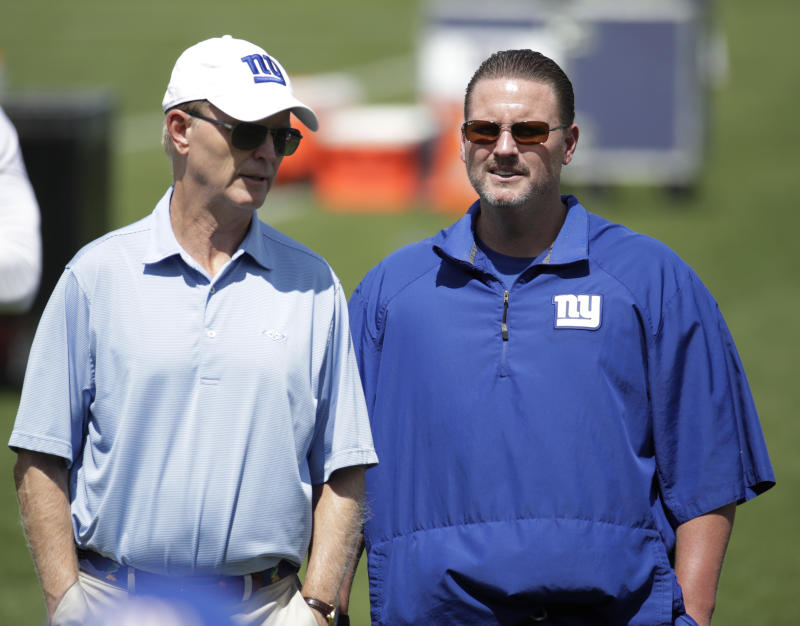 Giants co-owner John Mara (R), talking with head coach Ben McAdoo, told reporters how he has softened his stance over players protesting during the national anthem. (AP)