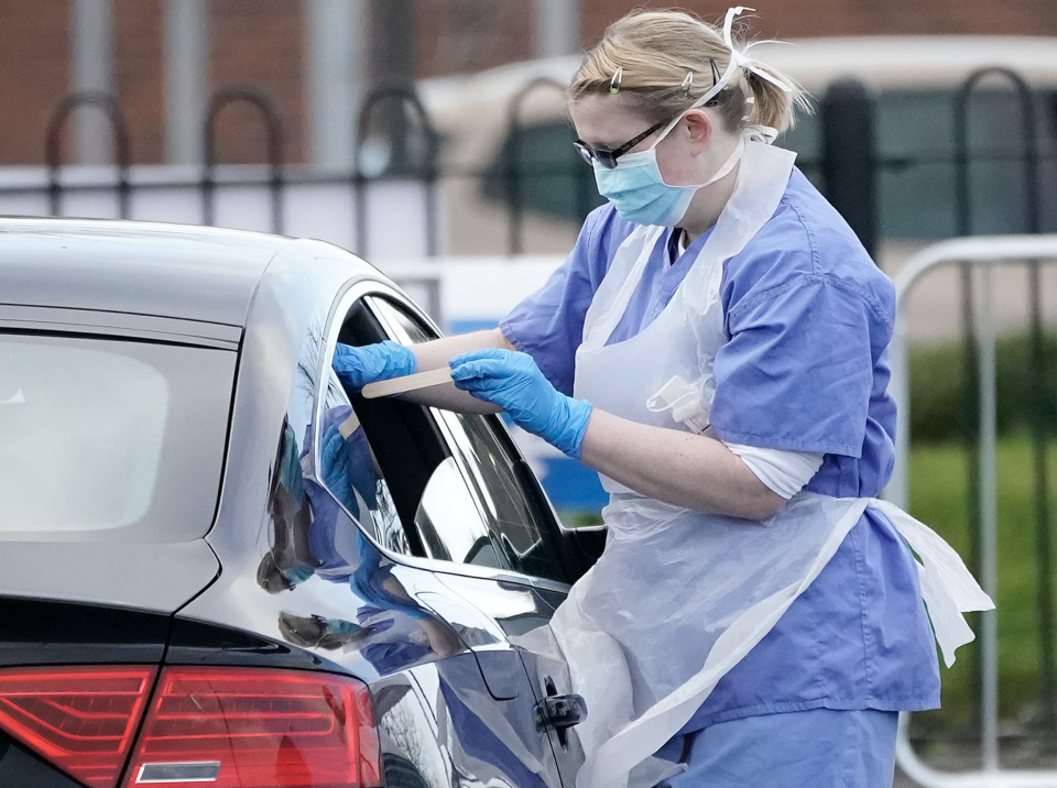 A member of the public is swabbed at a drive through Coronavirus testing site set up in a car park on March 12, 2020 in Wolverhampton, England. (Photo: Christopher Furlong/Getty Images)