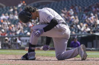 Colorado Rockies' Josh Fuentes reacts after striking out against the San Francisco Giants during the sixth inning of a baseball game in San Francisco, Sunday, April 11, 2021. (AP Photo/Jeff Chiu)