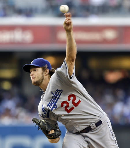 Los Angeles Dodgers starting pitcher Clayton Kershaw deliveres against the San Diego Padres in the first inning of a baseball game Saturday, Sept. 21, 2013, in San Diego. (AP Photo/Lenny Ignelzi)