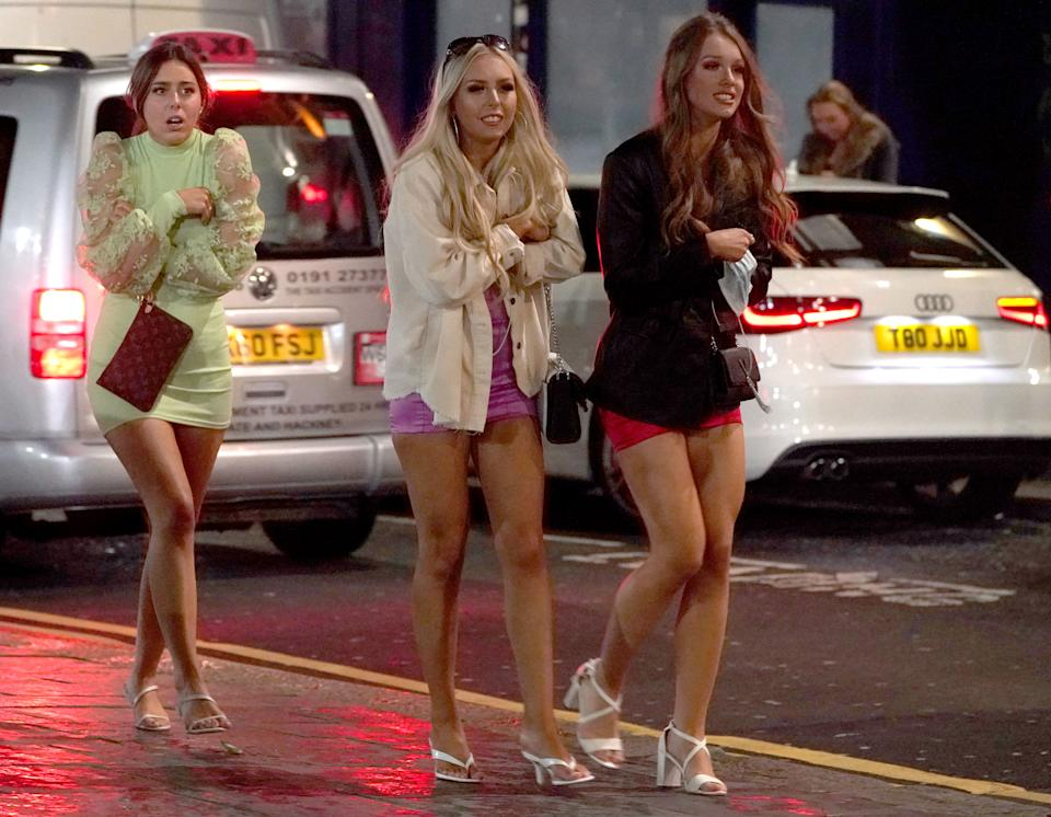 People out socialising in Newcastle city centre make their way home, after the 10pm curfew that pubs and restaurants in England are subject to in order to combat the rise in coronavirus cases. Cities in northern England and other areas suffering a surge in Covid-19 cases may have pubs and restaurants temporarily closed to combat the spread of the virus.
