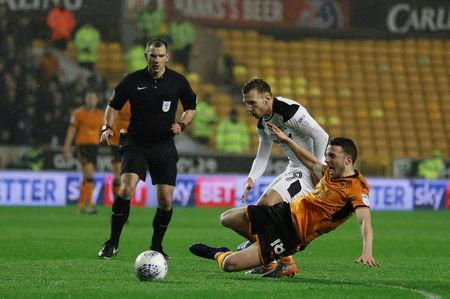 Soccer Football - Championship - Wolverhampton Wanderers vs Derby County - Molineux Stadium, Wolverhampton, Britain - April 11, 2018 Wolverhampton Wanderers' Diogo Jota in action with Derby County's Andreas Weimann Action Images/Andrew Couldridge