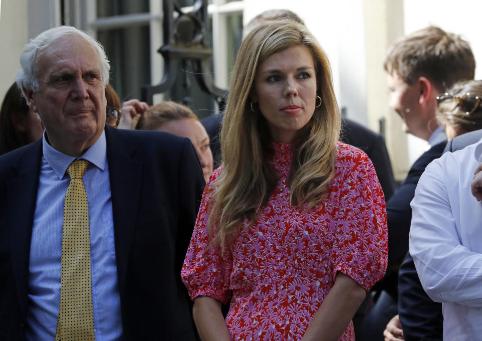 Carrie Symonds the girlfriend of Britain's new Prime Minister Boris Johnson waits in 10 Downing Street, London, Wednesday, July 24, 2019. Boris Johnson has replaced Theresa May as Prime Minister, following her resignation last month after Parliament repeatedly rejected the Brexit withdrawal agreement she struck with the European Union. (AP Photo/Frank Augstein)