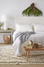 <p>Stick a freshly-cut bough above your headboard to bring the warm and cozy feeling into your bedroom. Then it's up to you whether you want to add in spruce accents to the rest of your space. </p>