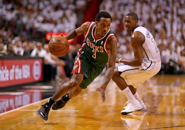 MIAMI, FL - APRIL 21: Brandon Jennings #3 of the Milwaukee Bucks drives on Mario Chalmers #15 of the Miami Heat during Game 1 of the Eastern Conference Quarterfinals of the 2013 NBA Playoffs at American Airlines Arena on April 21, 2013 in Miami, Florida. NOTE TO USER: User expressly acknowledges and agrees that, by downloading and or using this photograph, User is consenting to the terms and conditions of the Getty Images License Agreement. (Photo by Mike Ehrmann/Getty Images)