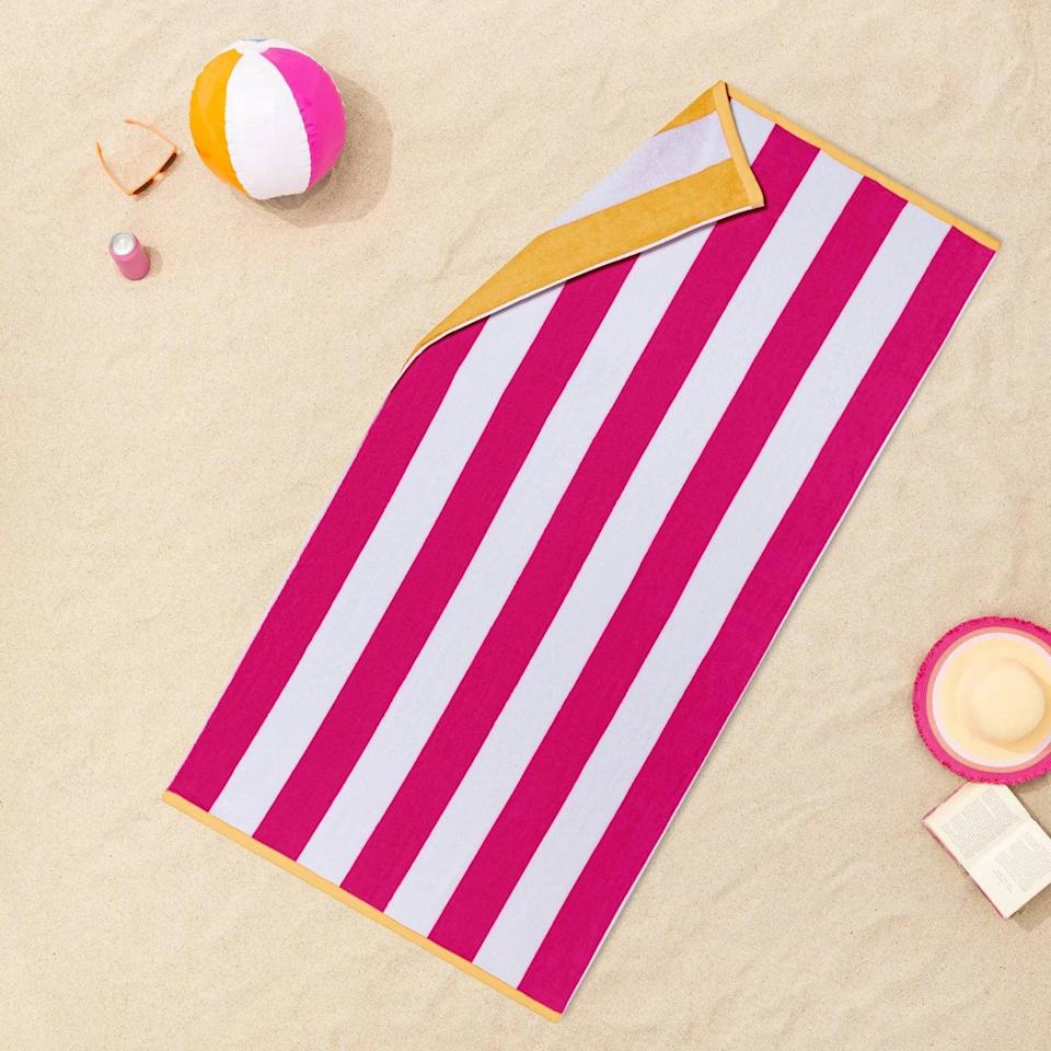 <p>If you can't decide between a color, get the best of both worlds with the <span>Sun Squad Reversible Cabana Striped Beach Towel</span> ($12).</p>