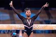 """<p><a href=""""https://people.com/tag/simone-biles/"""" rel=""""nofollow noopener"""" target=""""_blank"""" data-ylk=""""slk:The GOAT"""" class=""""link rapid-noclick-resp"""">The GOAT</a> needs no introduction. This is Biles' second Olympics; at the Rio Games in 2016 she took home five medals, and is poised to take more in Tokyo. She's already turning heads in Japan, <a href=""""https://people.com/sports/tokyo-olympics-simone-biles-nails-yurchenko-double-pike-vault-at-podium-training/"""" rel=""""nofollow noopener"""" target=""""_blank"""" data-ylk=""""slk:nailing the Yurchenko Double Pike"""" class=""""link rapid-noclick-resp"""">nailing the Yurchenko Double Pike</a> on vault during a practice session. (<em><a href=""""https://www.espn.com/olympics/gymnastics/story/_/id/31862188/simone-biles-throws-best-yurchenko-double-pike-yet-olympic-podium-training"""" rel=""""nofollow noopener"""" target=""""_blank"""" data-ylk=""""slk:ESPN"""" class=""""link rapid-noclick-resp"""">ESPN</a> </em>called the move """"the greatest Yurchenko double pike we've seen so far from her."""") Ahead of the Games, the 24-year-old was honored with her own Twitter emoji — <a href=""""https://people.com/sports/tokyo-olympics-simone-biles-custom-goat-twitter-emoji/"""" rel=""""nofollow noopener"""" target=""""_blank"""" data-ylk=""""slk:a goat, of course!"""" class=""""link rapid-noclick-resp"""">a goat, of course!</a></p>"""