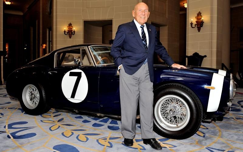 Sir Stirling Moss stands in front of the Ferrari 250 GT SWB, which he raced to victory in the Goodwood Tourist Trophy in 1961 - PA