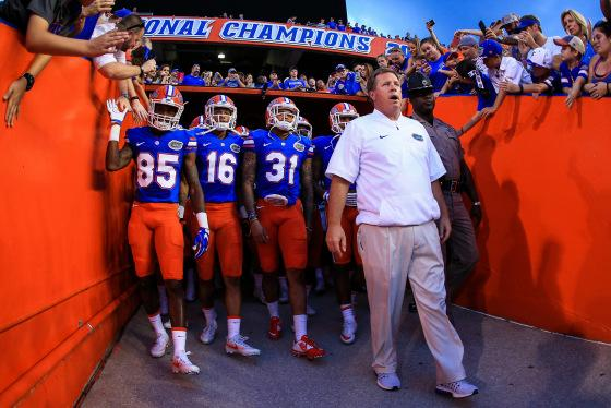 Head coach Jim McElwain leads the Florida Gators onto the field before the game against the North Texas Mean Green at Ben Hill Griffin Stadium on September 17, 2016 in Gainesville, Florida.