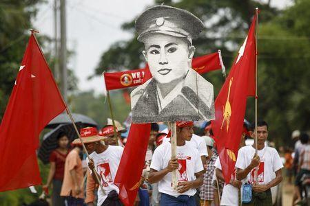 Supporters hold a picture of Myanmar national hero General Aung San, father of Myanmar pro-democracy leader Aung San Suu Kyi, during her campaign in her constituency of Kawhmu township outside Yangon September 21, 2015. REUTERS/Soe Zeya Tun