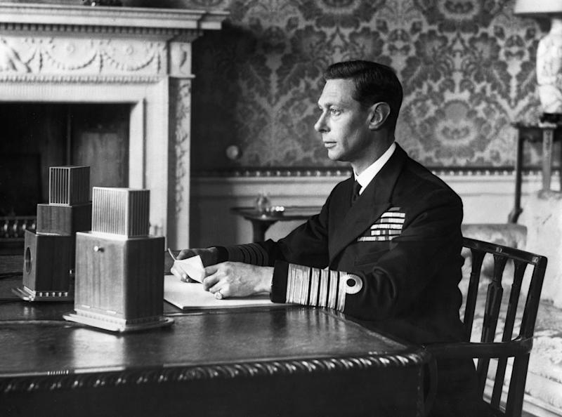 "King George VI addresses the British people over radio on September 4, 1939, one day after Britain declared war on Nazi Germany. He asked them to ""stand calm, firm, and united"" against what was to come. (Photo by © Hulton-Deutsch Collection/CORBIS/Corbis via Getty Images)"