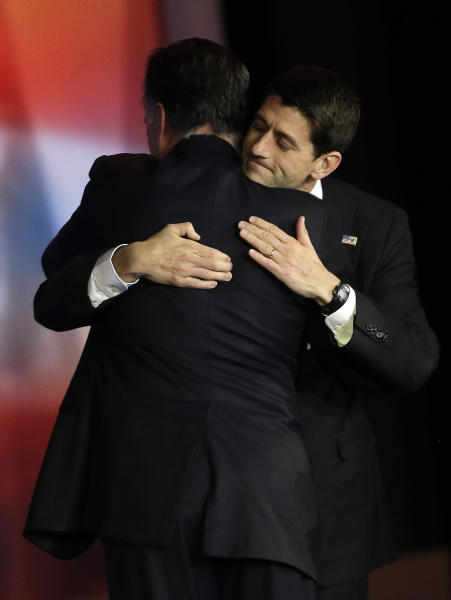 Republican presidential candidate and former Massachusetts Gov. Mitt Romney embraces Republican vice presidential candidate, Rep. Paul Ryan, R-Wis., after Romney conceded the race during his election night rally, Wednesday, Nov. 7, 2012, in Boston. (AP Photo/David Goldman)