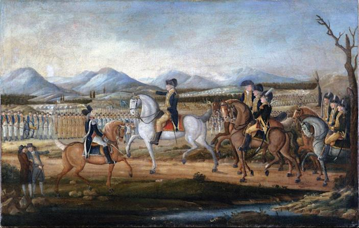Men on horses review columns of troops