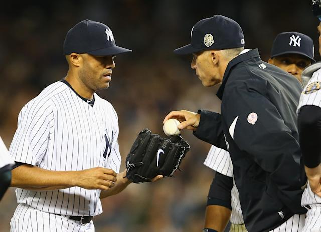 NEW YORK, NY - SEPTEMBER 26: Mariano Rivera #42 of the New York Yankees is handed the ball by Manager Joe Girardi #28 to pitch for the final time at Yankee Stadium in the eigth inning against the Tampa Bay Rays in the eigth inning during their game on September 26, 2013 at Yankee Stadium in the Bronx borough of New York City. (Photo by Al Bello/Getty Images)