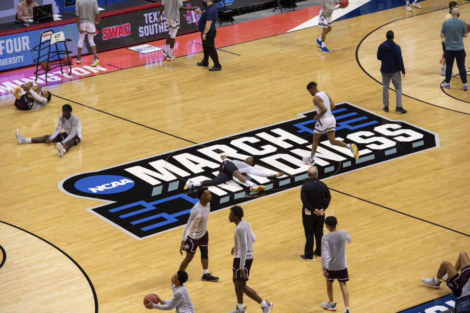 Players warm up on the court before the start of a First Four game between Texas Southern and Mount St. Mary's in the NCAA men's college basketball tournament, Thursday, March 18, 2021, in Bloomington, Ind. (AP Photo/Doug McSchooler)