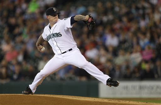 Seattle Mariners starting pitcher Jeremy Bonderman winds up in the first inning of a baseball game against the Oakland Athletics, Sunday, June 23, 2013, in Seattle. (AP Photo/Ted S. Warren)