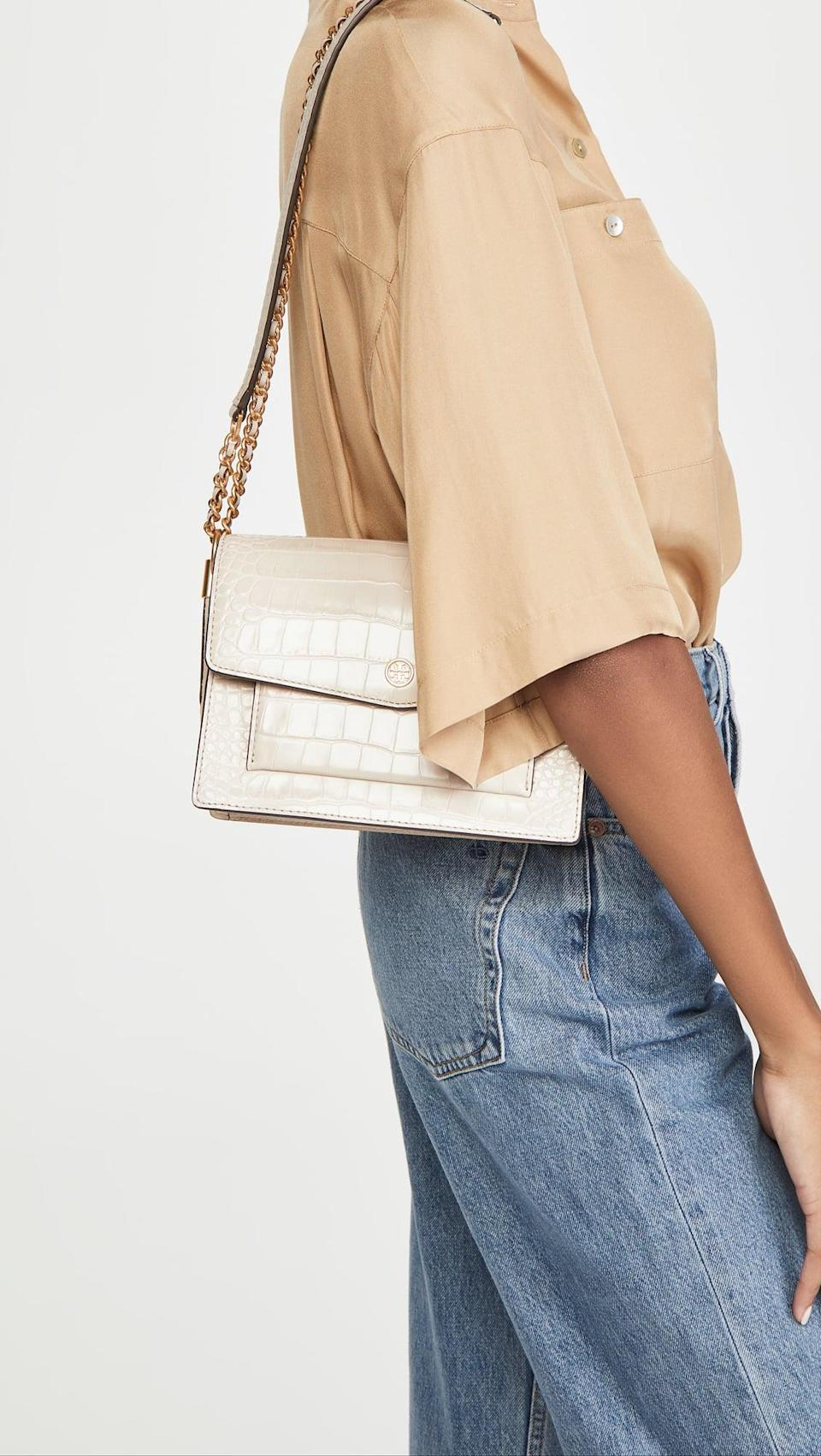 <p>This <span>Tory Burch Robinson Embossed Double Strap Convertible Bag</span> ($498) comes with a cute shorter strap and can be worn a variety of ways.</p>