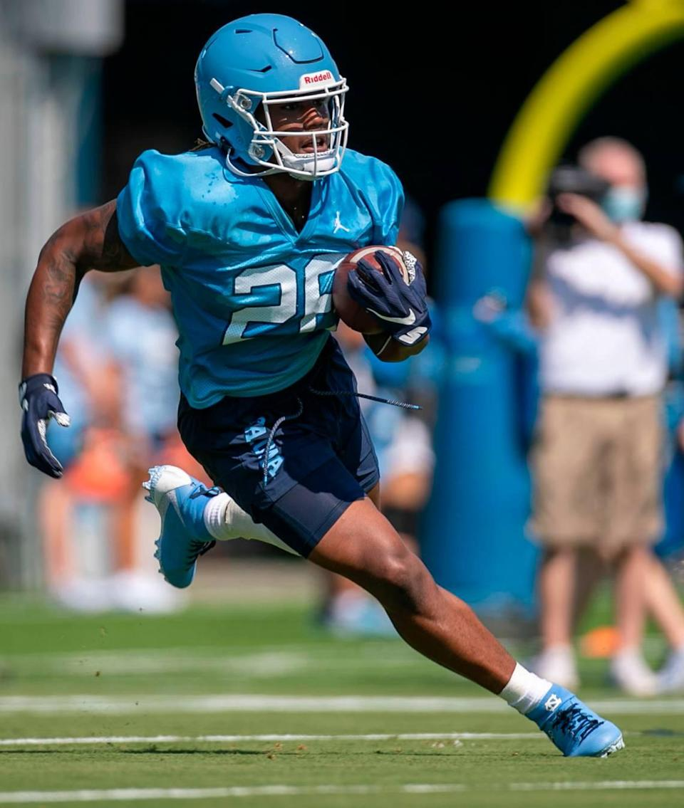 North Carolina running back D.J. Jones (26) carries the ball during the Tar Heels' first day of practice on Thursday, August 5, 2021 in Chapel Hill N.C.