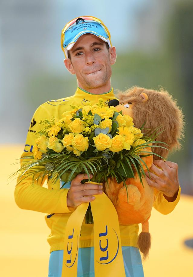 Race winner Vincenzo Nibali of Italy, wearing the overall leader's yellow jersey, celebrates on the podium of the Tour de France in Paris, France, Sunday, July 27, 2014. (AP Photo/Jerome Prevost, Pool)