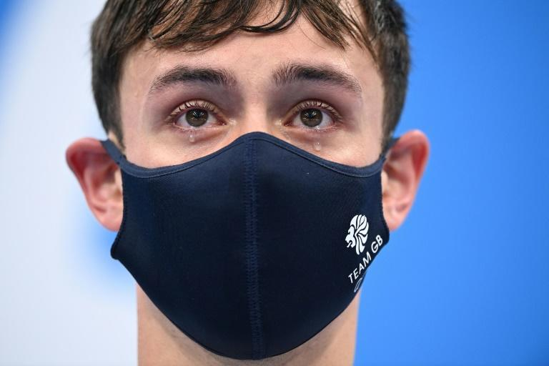 British diver Tom Daley holds back tears after his victory in the synchronised 10m platform event with Matty Lee