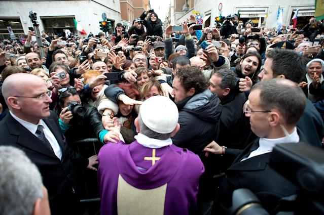 VATICAN CITY, VATICAN - MARCH 17: (EDITORIAL USE ONLY - STRICTLY NO COMMERCIAL OR MERCHANDISING USAGE - BOOKS OUT, BROADCAST OUT, All image rights and copyrights reserved to the photographic Service of L'Osservatore Romano). IMAGE IS NOT LICENSED FOR USAGE BEYOND 60 DAYS OF CREATE DATE. Pope Francis greets the faithful outside the Church of Sant'Anna after celebrating Sunday Mass Service on March 17, 2013 in Vatican City, Vatican. The inauguration mass of Pope Francis, the first ever Latin American Pontiff, will be held on March 19, 2013 in Vatican City. (Photo by Servizio Fotografico L'Osservatore Romano via Getty Images)
