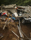 Debris of collapsed houses is pictures in the Blessem district of Erftstadt, Germany, Friday, July 16, 2021. Heavy rains caused mudslides and flooding in the western part of Germany. Multiple have died and dozens are missing as severe flooding in Germany and Belgium turned streams and streets into raging, debris-filled torrents that swept away cars and toppled houses. (David Young/dpa via AP)