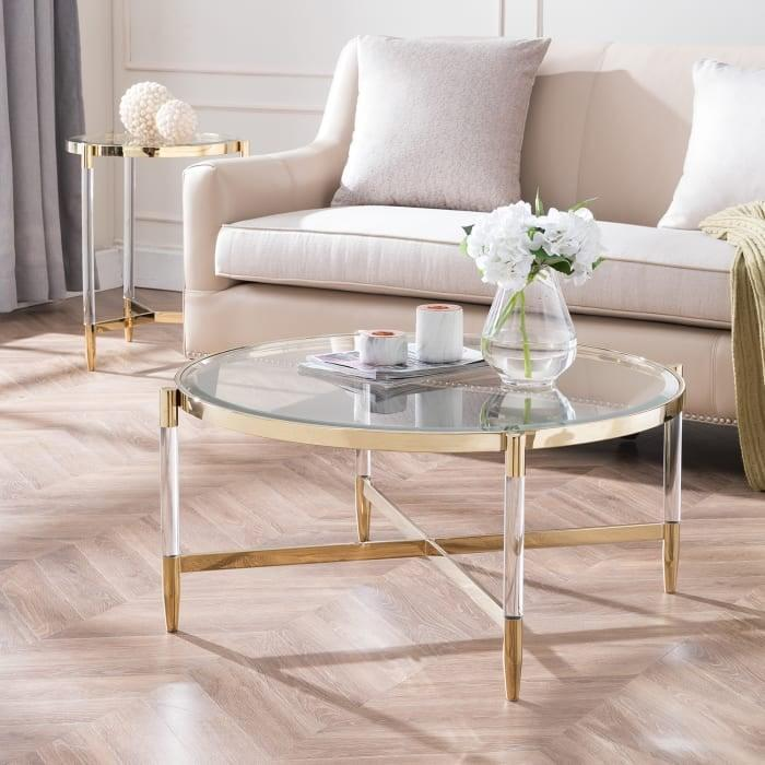 <p>If you love gold accents, consider this <span>Benson Acrylic Cocktail Table</span> ($400, originally $540), which blends style and functionality well.</p>
