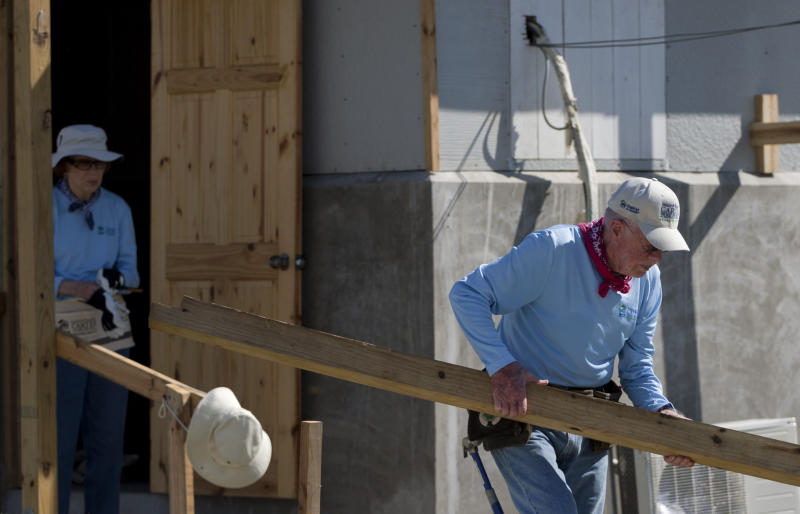 Former President Jimmy Carter, right, and his wife Rosalynn help to build a home at a Habitat for Humanity project in Leogane, Haiti, Monday, Nov. 26, 2012. The former president and former first lady were both taking an active part Monday in the construction of 100 one-room houses on about 14 acres. Families will get to live in the homes rent-free for five years and then will have to pay a modest annual rent to the government. (AP Photo/Dieu Nalio Chery)