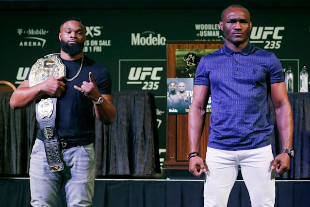 Tyron Woodley (L) and Kamaru Usman pose for photographers during the UFC 235 news conference on Jan. 31, 2019, in Las Vegas. (AP)