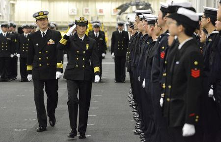 Newly-appointed Commander of First Escort Division of JMSDF Ryoko Azuma salutes to soldiers in Yokohama