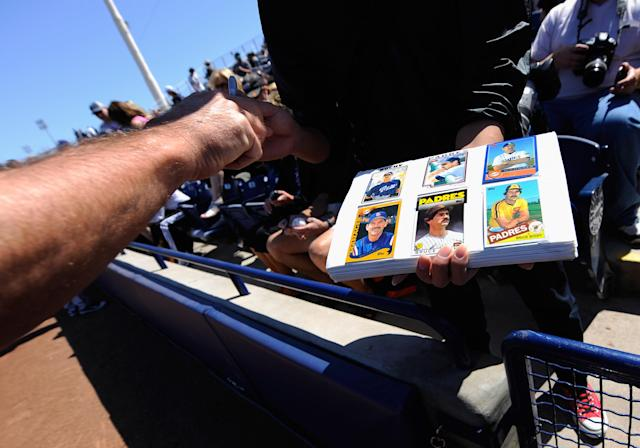 PEORIA, AZ - MARCH 08: Bruce Botchy manager of the San Francisco Giants signs baseballs and baseball cards prior to the start of the spring training baseball game against Seattle Mariners at Peoria Stadium on March 8, 2011 in Peoria, Arizona. (Photo by Kevork Djansezian/Getty Images)