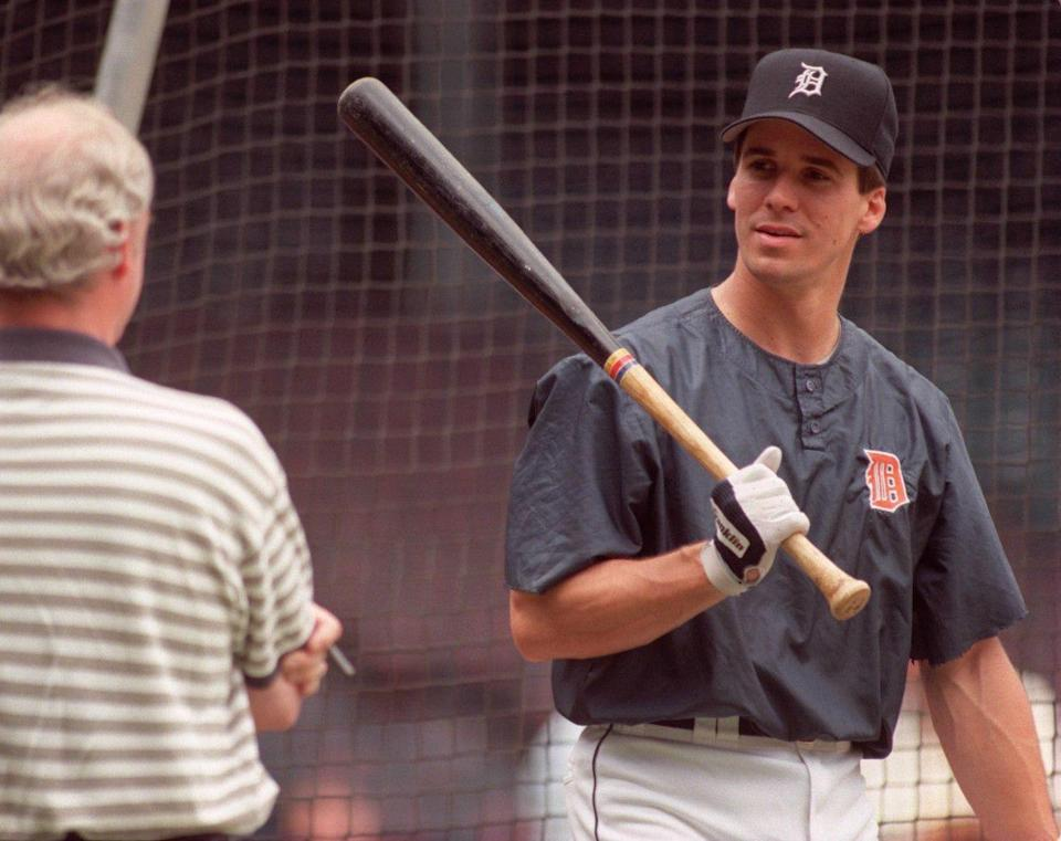 Tigers third baseman Travis Fryman talks with folks outside the batting cage before he takes batting practice the game against Milwaukee on July 3, 1996, at Tiger Stadium.