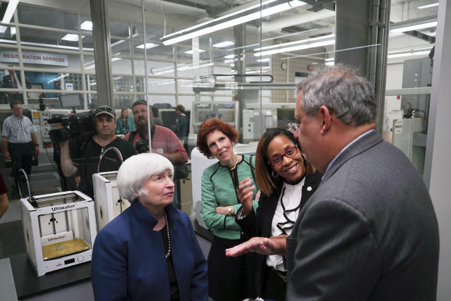 Federal Reserve Chair Janet Yellen, left, speaks to Arthur F. Anton, CEO of Swagelok, a manufacturing company, during a job training center tour in Cleveland, Ohio on Tuesday, Sept. 26, 2017. (AP Photo/Dake Kang)