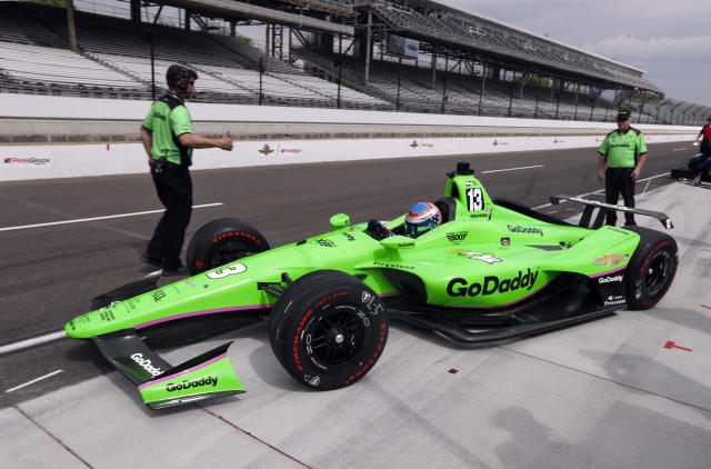 Danica Patrick pulls out of the pit area on the opening day of practice for the Indy 500 auto race at Indianapolis Motor Speedway in Indianapolis, Tuesday, May 15, 2018. (AP Photo/Michael Conroy)