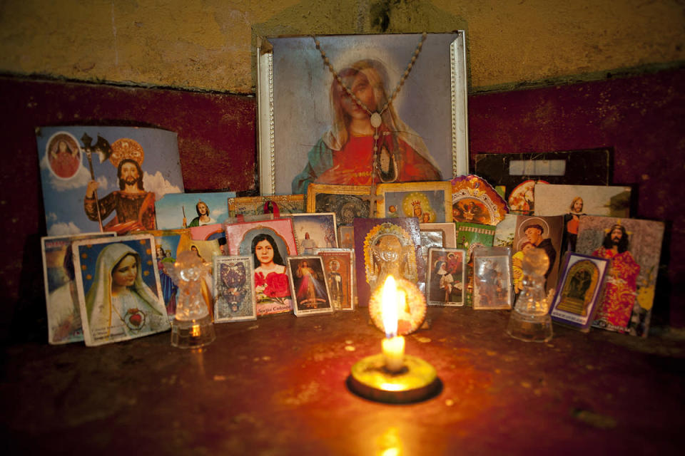 <p>Tamara, who keeps a collection of saints in the corner of her room with a lighted candle, often talks about how she will not live past 30. (Photo: Danielle Villasana) </p>