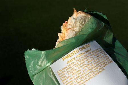 A pimento cheese sandwich is seen in its green plastic wrapper at Augusta National Golf Club in Augusta, Georgia, U.S. April 4, 2017. REUTERS/Jonathan Ernst