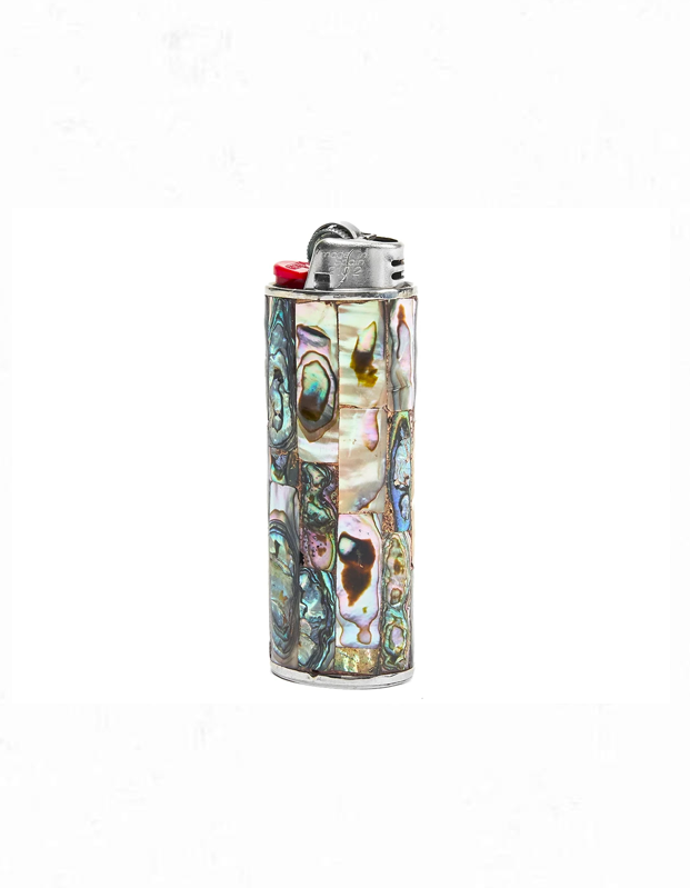 "Complete the package with a one-of-a-kind iridescent abalone shell lighter cover, sourced from Mexico and handmade in high-quality silver metal. $50, Tetra. <a href=""https://www.shop-tetra.com/collections/lighters/products/vintage-abalone-lighter-cover?variant=29608907178062"" rel=""nofollow noopener"" target=""_blank"" data-ylk=""slk:Get it now!"" class=""link rapid-noclick-resp"">Get it now!</a>"