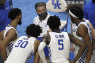 Kentucky head coach John Calipari, top center, instructs his team during a time out in the second half of an NCAA college basketball game against Notre Dame in Lexington, Ky., Saturday, Dec. 12, 2020. Notre Dame won 64-63. (AP Photo/James Crisp)