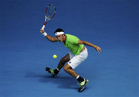 Leonardo Mayer of Argentina hits a return to Novak Djokovic of Serbia during their men's singles match at the Australian Open 2014 tennis tournament in Melbourne January 15, 2014. REUTERS/Jason Reed