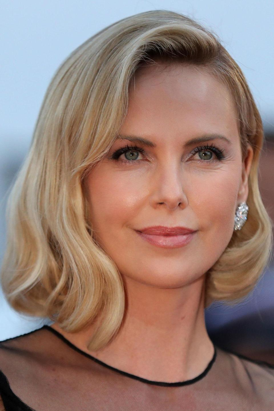 <p>Theron went for a classic beauty look; her long bob styled in a vintage wave with subtle silvery eyes and dusty pink lips.</p>